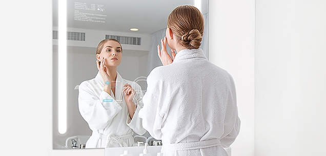 Woman using QAIO Smart Mirror